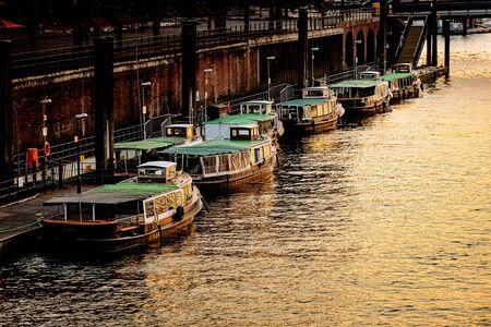 Old barges in the port of Hamburg. Dusk. Vertical.