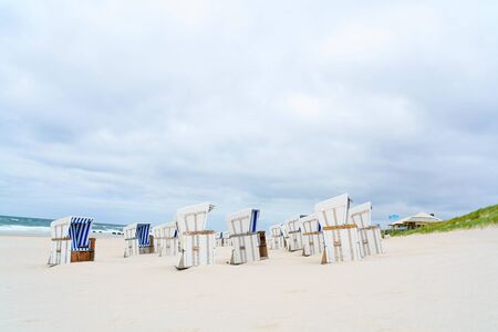 Beach - chairs on the island Sylt vertical. Germany. Stock fotó
