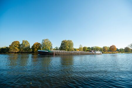 An empty barge flows along the Odra channel.