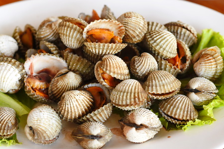 Steamed blanched clams with dipping sauce Stock Photo