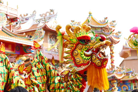 Chinese dragon and lion dance Imagens