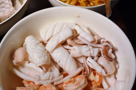 squid and shrim meat in boil rice