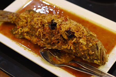 Deep fried grouper fish with chili sauce