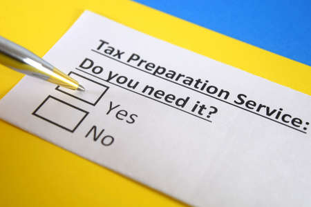 One person is answering question about tax prepration service. Standard-Bild