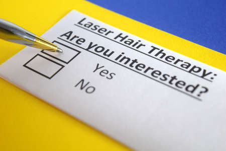 One person is answering question about laser hair therapy.