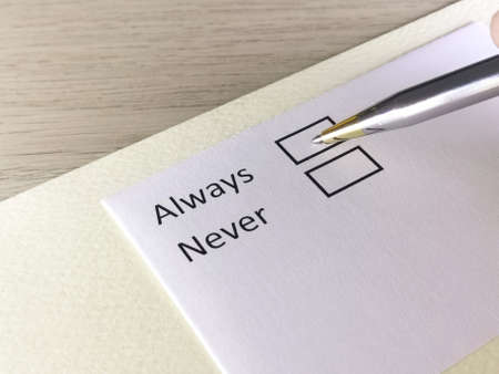 One person is answering question on a piece of paper. The person is thinking to be always or never.