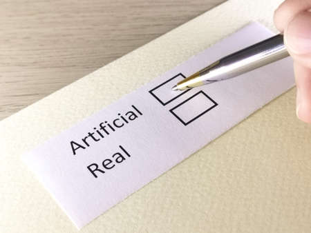 One person is answering question on a piece of paper. The person is thinking to choose artificial or real.