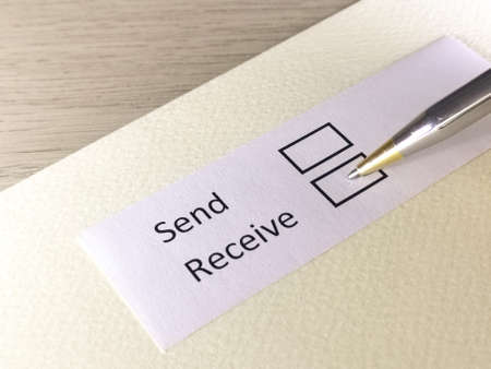 One person is answering question on a piece of paper. The person is thinking to send or to receive.