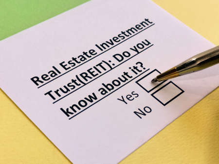 A person is answering question about real estate investment trust (REIT).