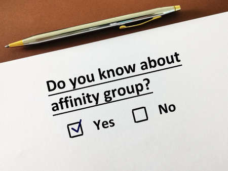 One person is answering question about tourism. He knows about affinity group.