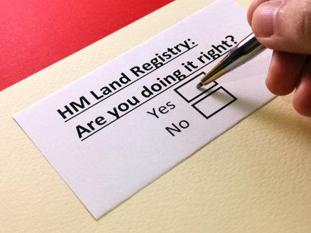 One person is answering question about HM land registry. Foto de archivo