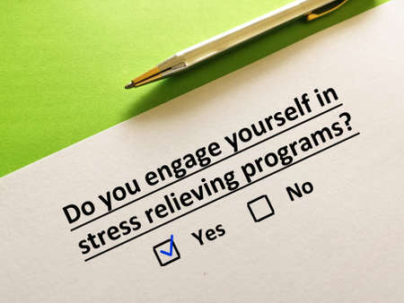 One person is answering question. The person is engaged in stress relieving programs.