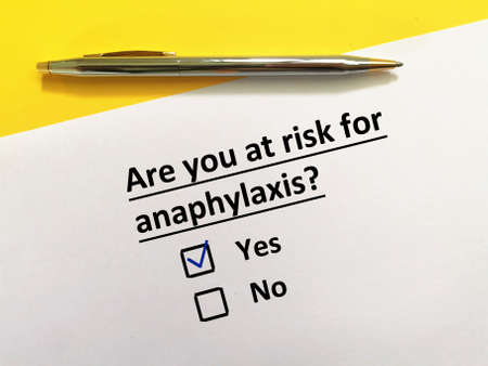 One person is answering question about vaccines. The person is at risk for anaphylaxis. Stock fotó