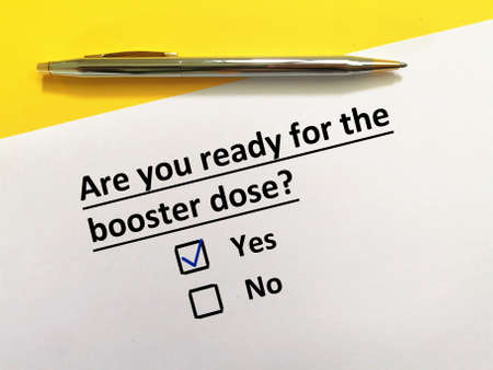 One person is answering question about vaccines. The person is ready for the booster dose.