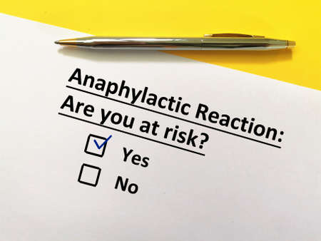 One person is answering question about vaccines. The person is at risk for anaphylactic reaction