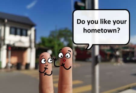 Two fingers are decorated as two person. One of them is asking another what does he like about his hometown.