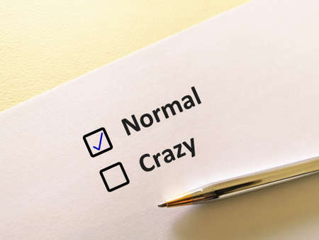 One person is answering question. He chooses to be normal.