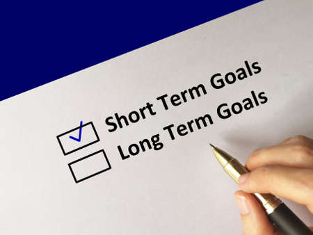 One person is answering question. He chooses short term goals.