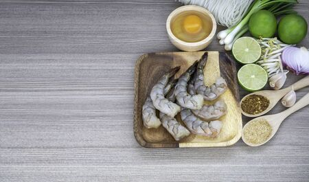 Fried rice sticks with shrimp ingredients cooking on wooden table 写真素材 - 132048624