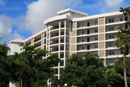 Tropical apartment building over looking a golf course