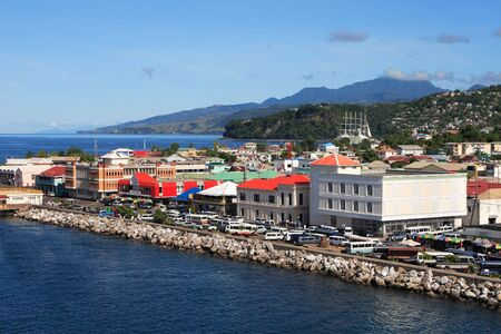 dominica: Cruise coming into a caribbean city Roseau on the island of Dominica