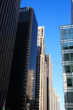 Reflective corporate buildings on a clear day in manhattan