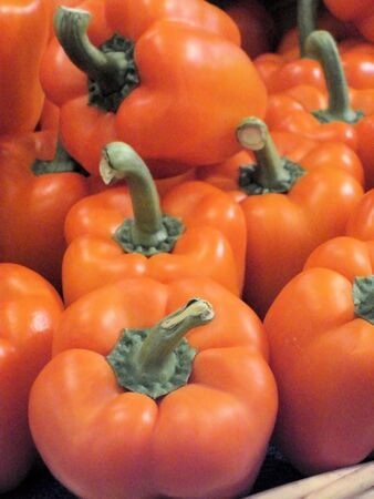 luster: Orange peppers on display at a local market Stock Photo