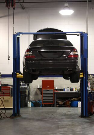 hoist: Automobile on a lift for servicing and repair