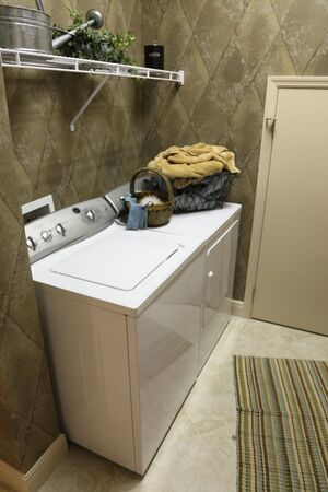 dryer: New, modern laundry room with shelf and appliances