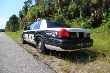 car crime: Highway patrol car sitting on the side of the road