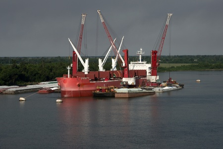 Freighter ship loading sugar on the mississippi river