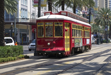 fare: Red trolley streetcar on rail in New Orleans French Quarter