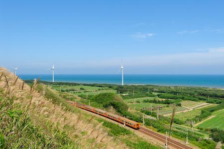 wind force wheel: rainway at the coastline with wind turbine