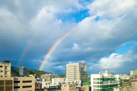 虹と台北市の都市景観 写真素材
