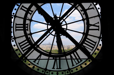 View through dorsay clock tower in Paris, France