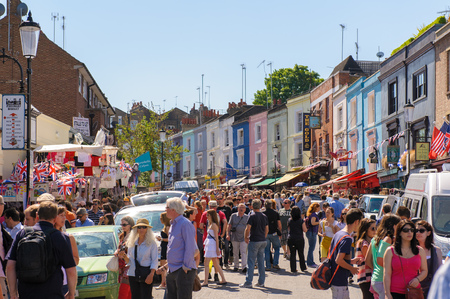 clear day: street view of portobello road market in notting hill, london, Uk Editorial
