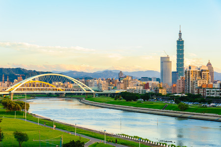 skyline of the taipei city by the river 写真素材