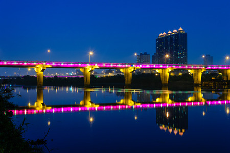 moon  metropolis: Night scene of Taipei city with abridge over the river