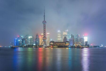 huangpu: skyline of shanghai city by the huangpu river at night