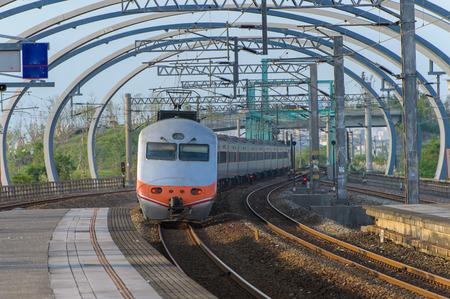 Train approaching the Dongshan Station in Yilan, Taiwan Image ID: 348705353