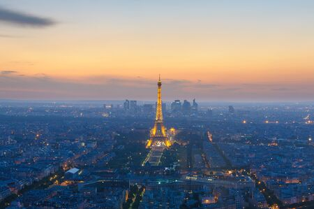 church tower: cityscape of paris in the dusk with eiffel tower