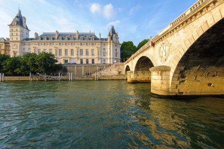 cite: riverside of seine river in Paris, France by the sunset