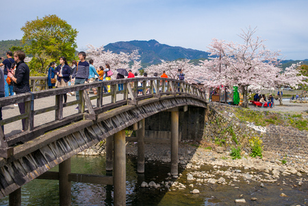 touristy: Tourists walk on the bridges of Arashiyama. It is a pleasant, touristy district in the western outskirts of Kyoto