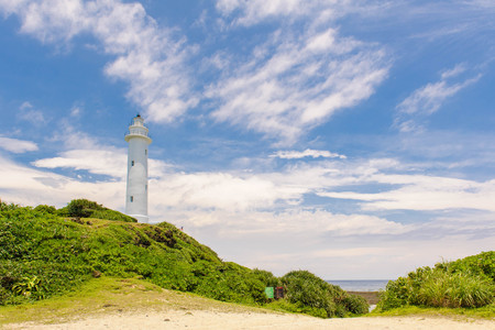 lighthouse under the blue sky in green island 版權商用圖片