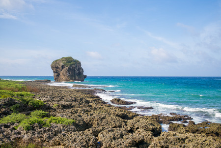 kenting: Landscape of Kenting with Chuanfan Rock Stock Photo