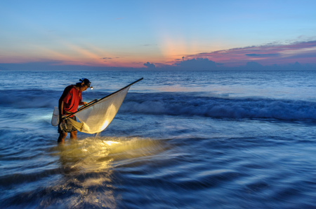traditional method to catch fish with triangle fishing net in jinlun, taitung, taiwan.