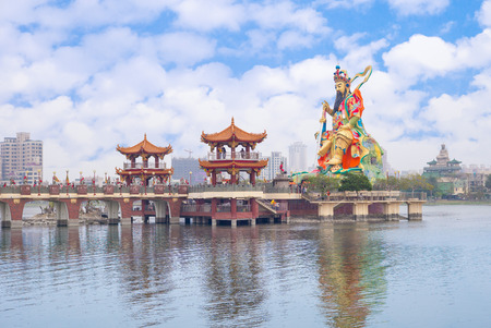 multiples: landscape of lotus pond in kaohsiung with Taoist god statue Editorial