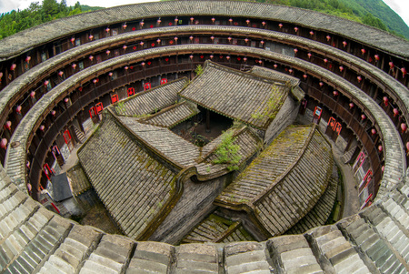 Aerial view of fujian tulou (hakka roundhouse). There are couplets with lucky poem on every door.
