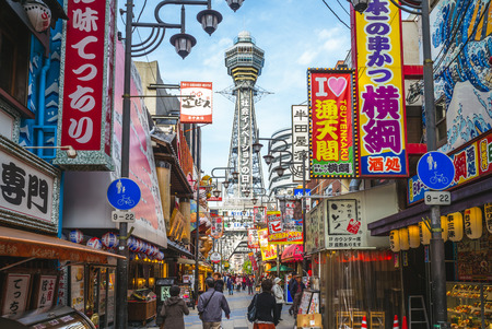 Osaka, Japan - November 21, 2018: street view of Shinsekai and Tsutenkaku tower in osaka.  shinsekai is a retro downtown area of southern Osaka