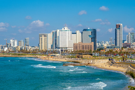 skyline of Tel Aviv, Israel by the beach at dusk